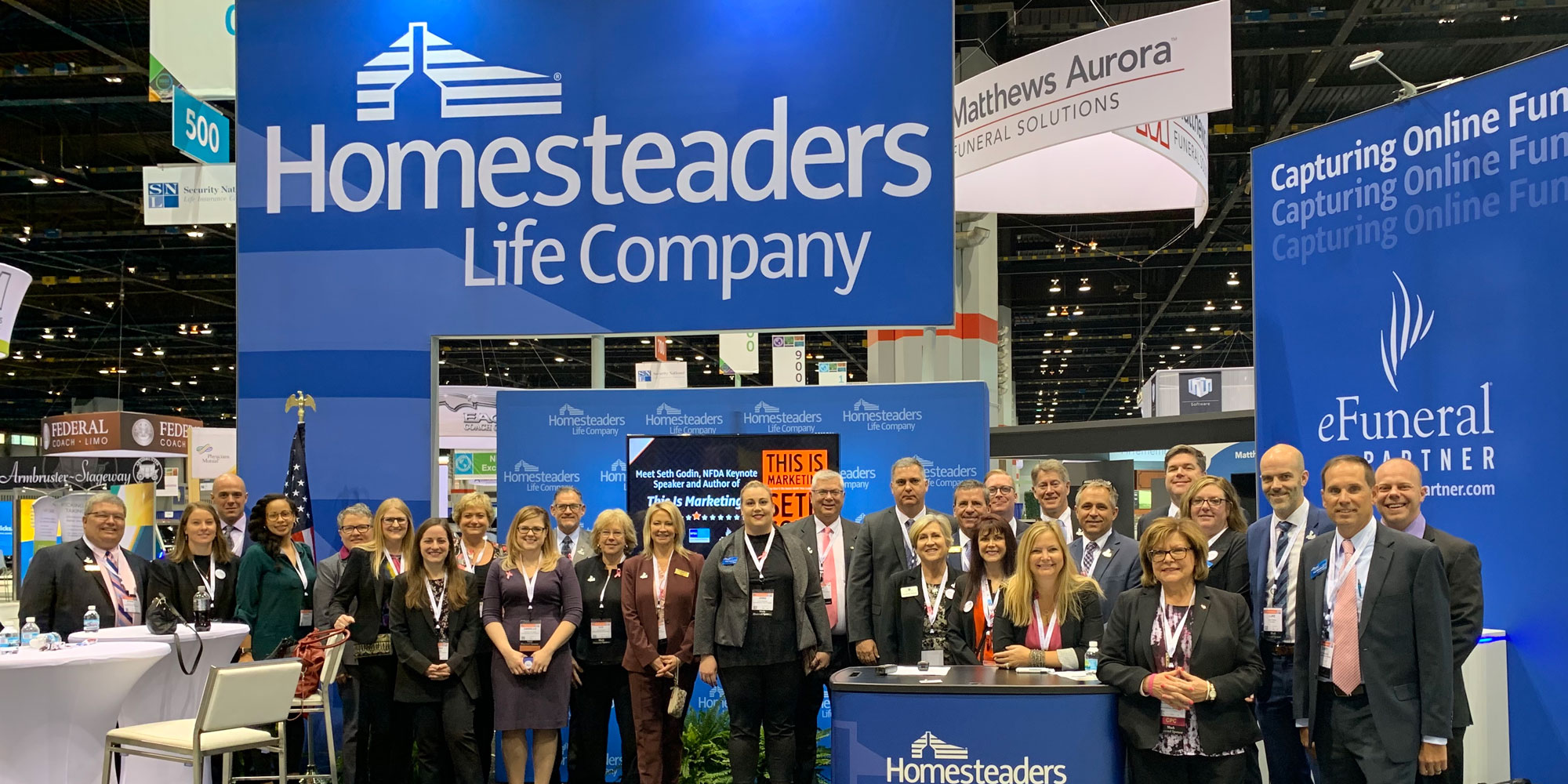 Homesteaders and eFuneral employees at convention booth