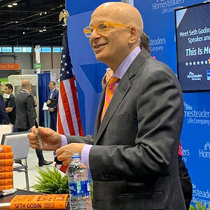 Seth Godin signing books at the convention